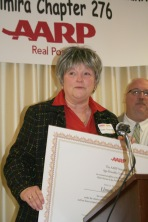 City of Elmira Mayor Sue Skidmore receiving Age-Friendly Community certificate